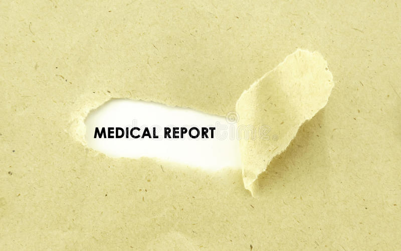 MEDICAL REPORT. Text MEDICAL REPORT appearing behind torn light brown envelope stock image