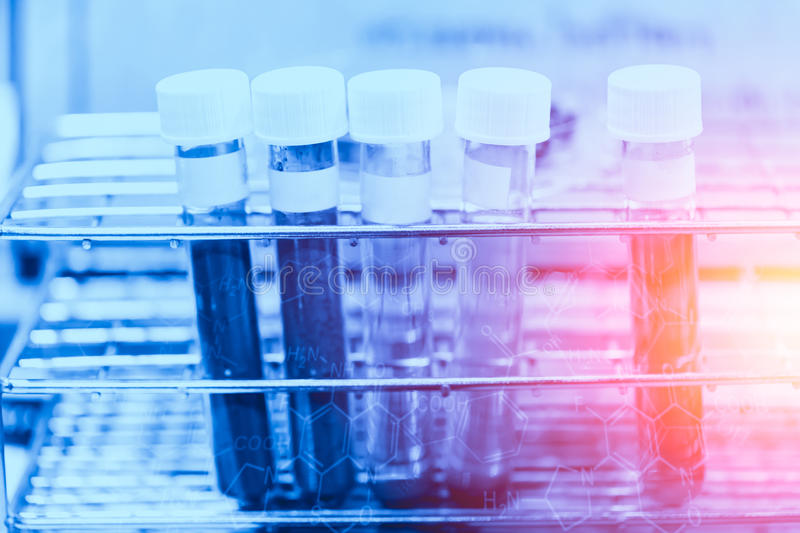 Medical research chemical lab concept. Chemical sample science test in sci tube on blue color tone for background stock photography