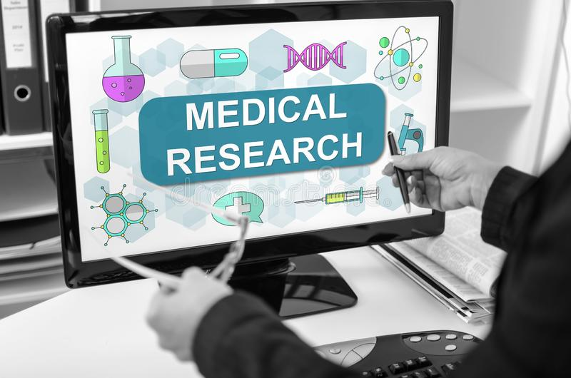 Medical research concept on a computer monitor. Businesswoman showing medical research concept on a computer screen royalty free stock image