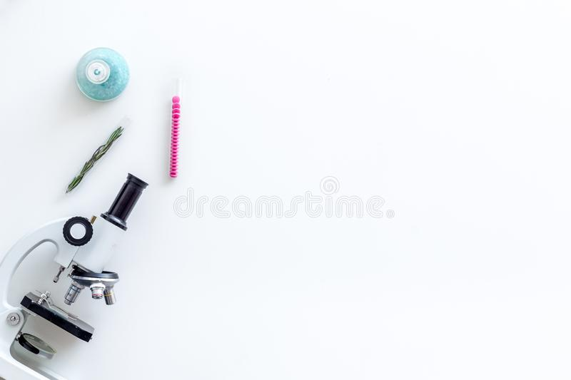 Medical research with microscope, pills in test tube on white background top view space for text. Desk of doctor in laboratory. Medical research with microscope stock image