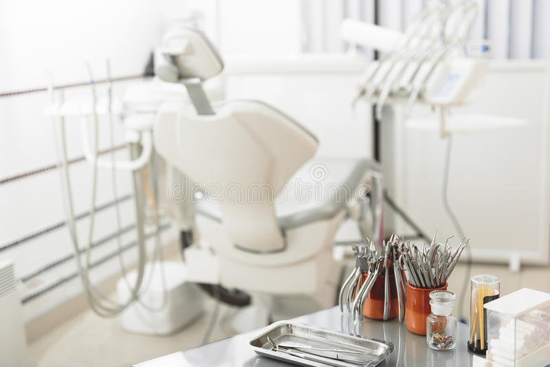 Medical room with odontological device and instruments stock photo