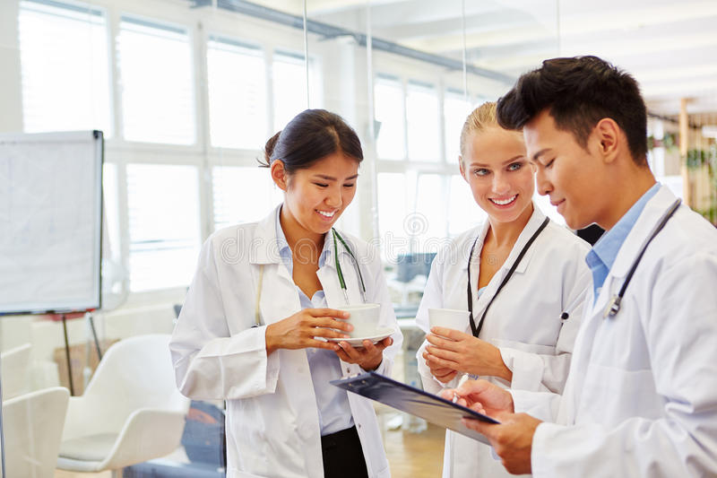 Medical school students discussing therapy. And learn together at seminar stock photography
