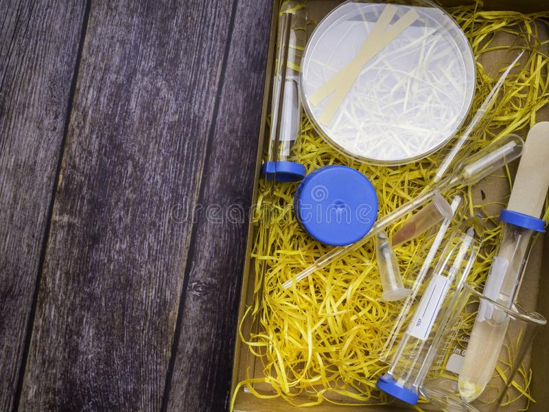 Medical science laboratory glassware, scientific equipment for researching in medicine and chemistry. In yellow shavings stock image