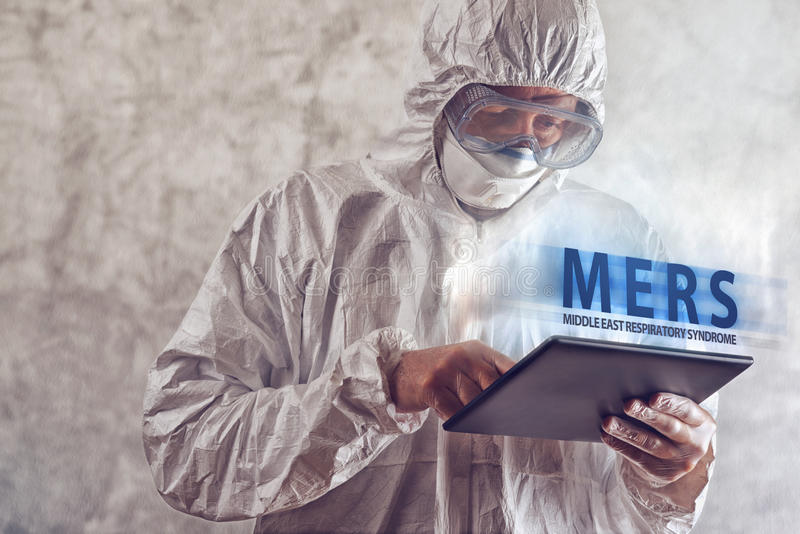 Medical Scientist Reading About MERS Virus on Figital Tablet Com. Medical Scientist Reading Internet Pages About MERS Virus on Figital Tablet Computer stock images
