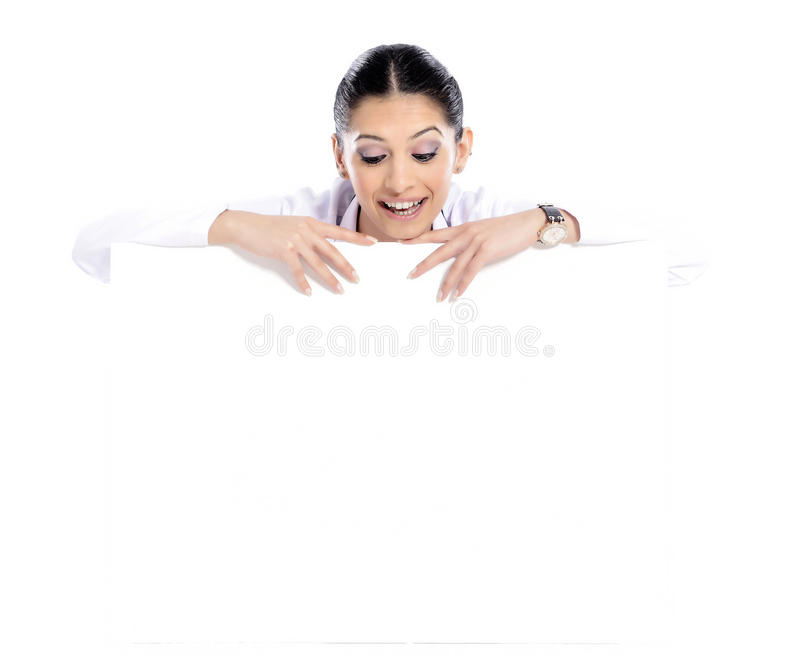 Medical sign doctor nurse. Doctor - Nurse showing medical sign billboard standing in full length. Young smiling nurse or doctor in scrubs showing empty blank stock images