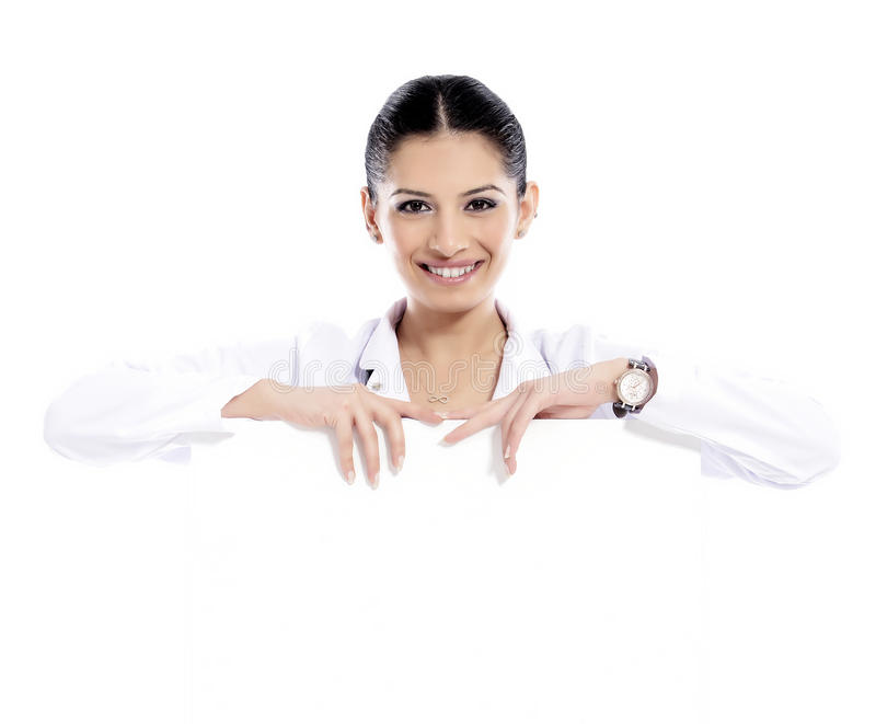 Medical sign doctor nurse. Doctor - Nurse showing medical sign billboard standing in full length. Young smiling nurse or doctor in scrubs showing empty blank royalty free stock photos