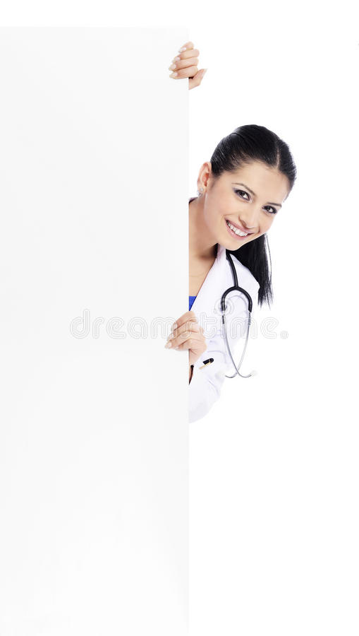 Medical sign doctor nurse. Doctor - Nurse showing medical sign billboard standing in full length. Young smiling nurse or doctor in scrubs showing empty blank stock photos