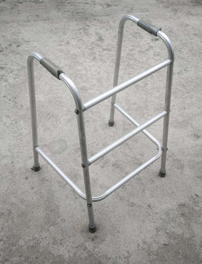 Medical special equipment, walkers, crutches and walking-sticks. To assist in the movement and care of disabled and elderly people on concrete floor royalty free stock image