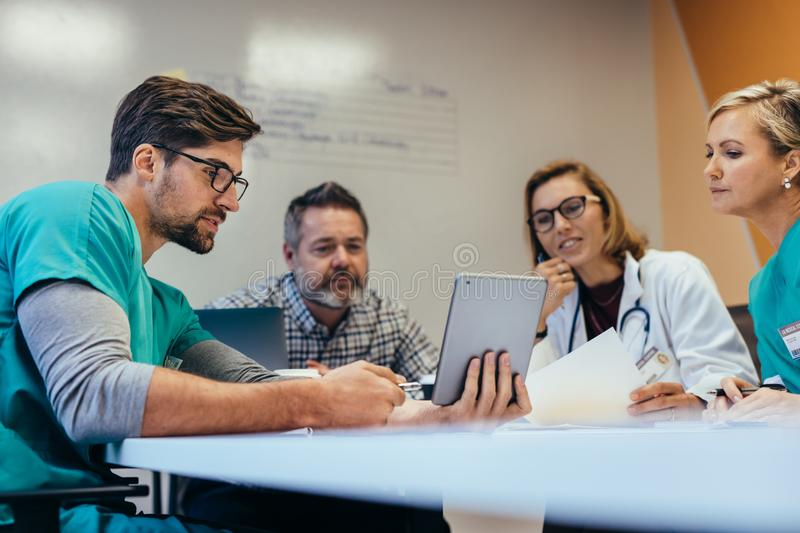 Medical staff having morning meeting in boardroom stock photos