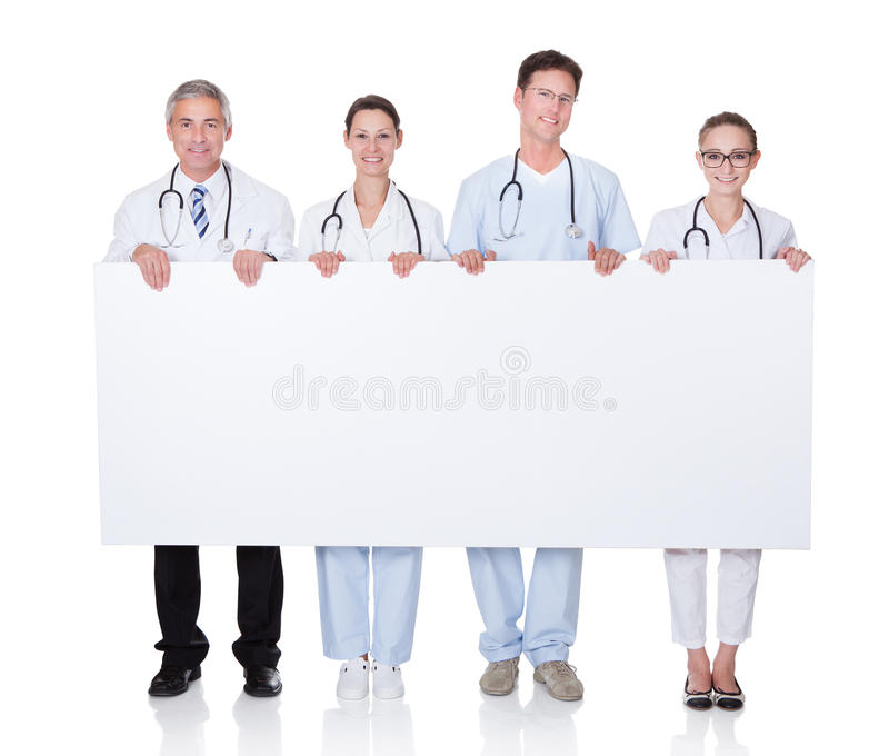Medical staff holding up a white banner stock image