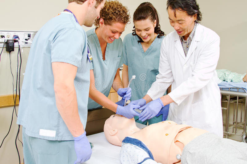 Medical staff practice intubating mannequin stock images