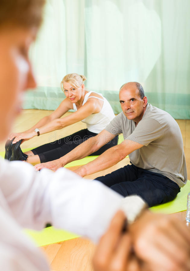 Medical staff with senior people at gym royalty free stock photography