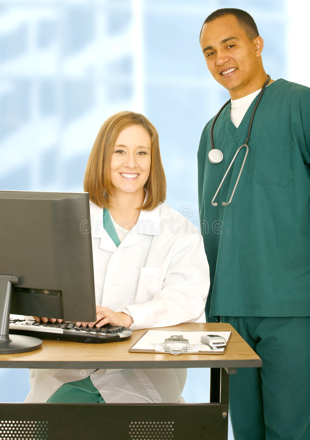 Medical Staff Team. Two medical staff posing as successful personnel standing with smile and confident royalty free stock images
