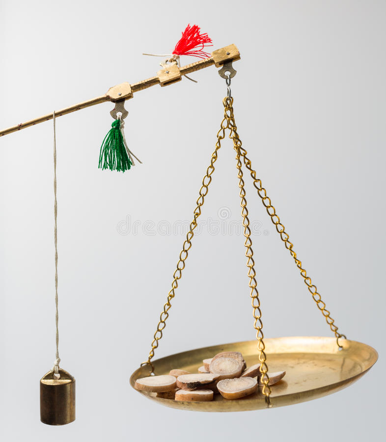 Medical Staff Weighs Chinese herbal medicine.  royalty free stock photography