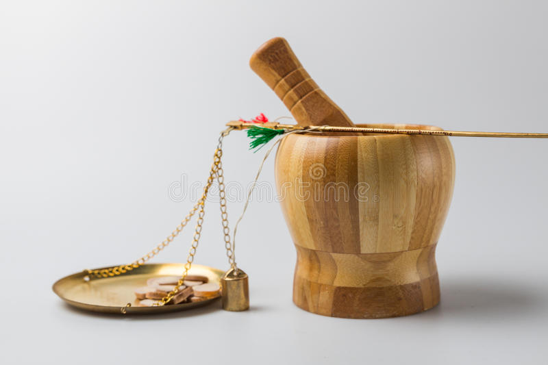 Medical Staff Weighs Chinese herbal medicine.  royalty free stock images