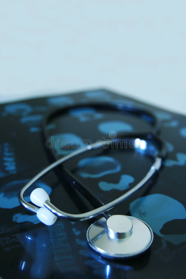 Medical stethoscope. A close up of a stethoscope and x ray royalty free stock photography
