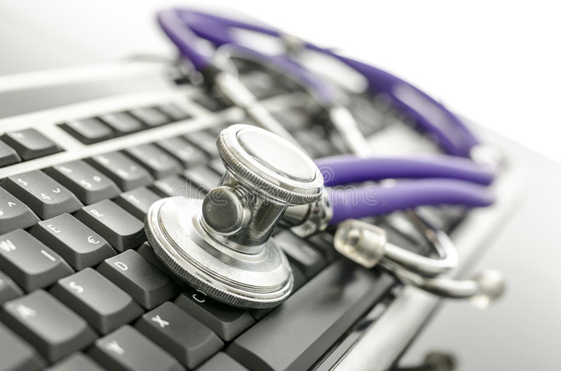 Medical stethoscope on computer keyboard. Concept of computer support stock photos