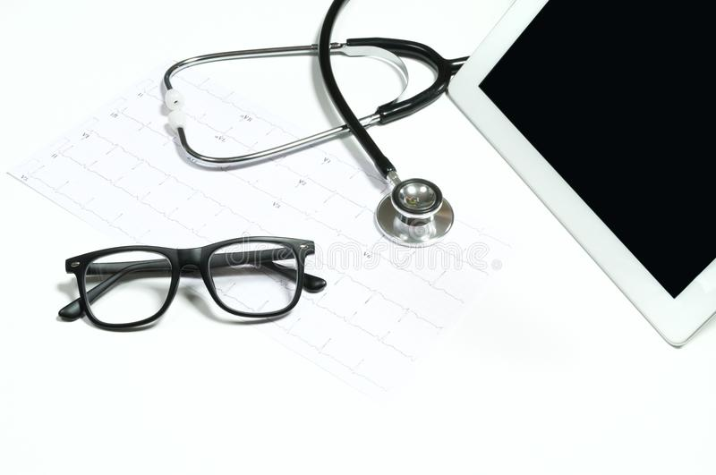 Medical stethoscope and digital tablet on white background. royalty free stock photography