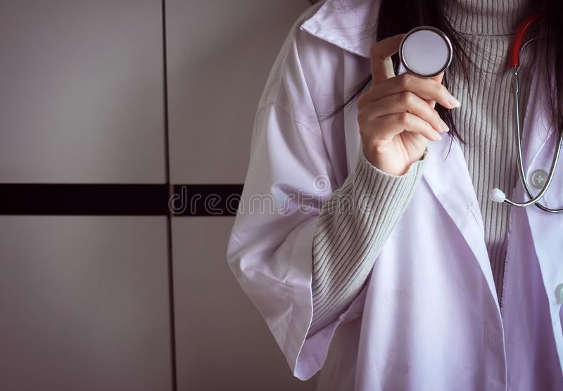 Medical stethoscope in hand,Doctor holding examination device for pulse royalty free stock image