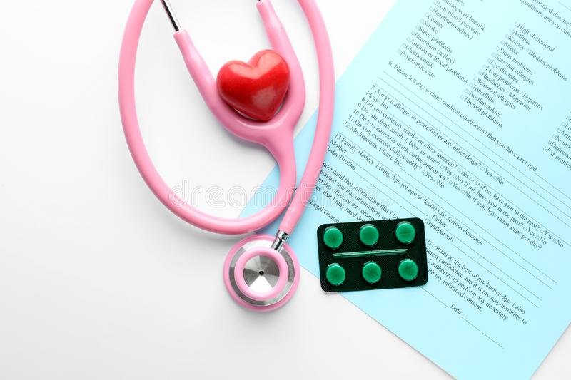 Stethoscope With Pills On Color Background  Health Care