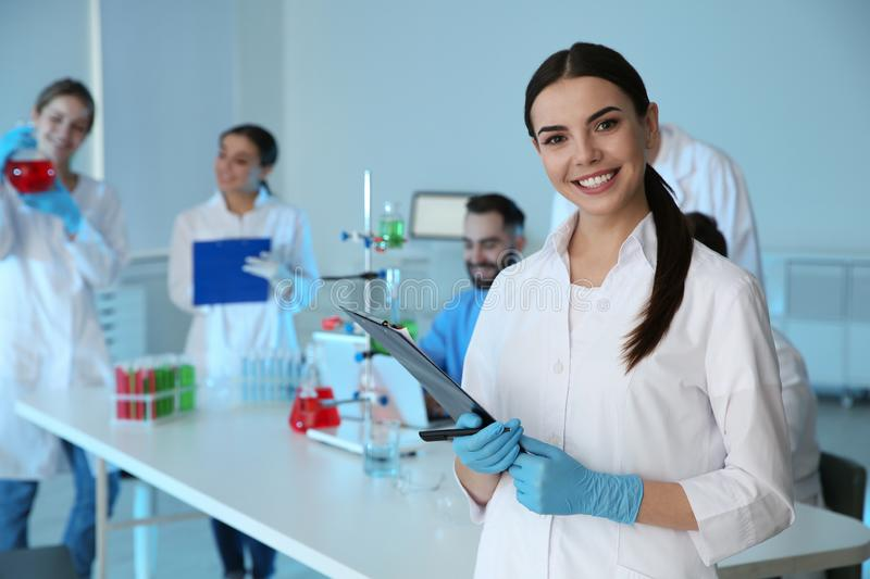 Medical student with clipboard in scientific laboratory. Medical student with clipboard in modern scientific laboratory royalty free stock photos