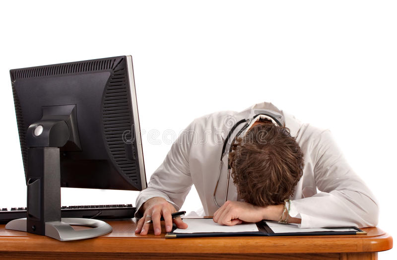 Medical Student Sleep in front of Computer. Isolated royalty free stock photo
