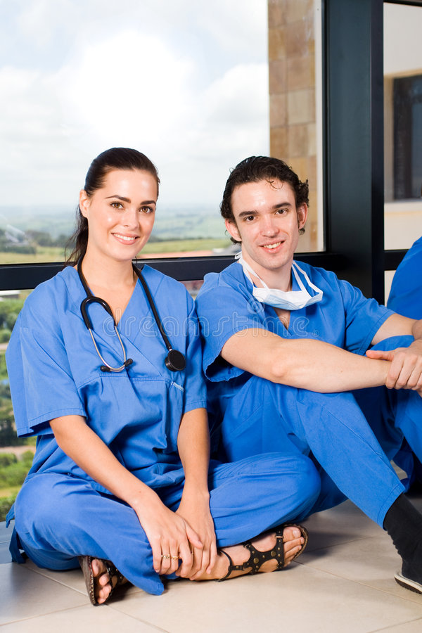 Medical students. Group of young medical students relaxing in hospital hallway royalty free stock photography