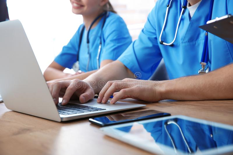 Medical students studying at table. Closeup view royalty free stock images