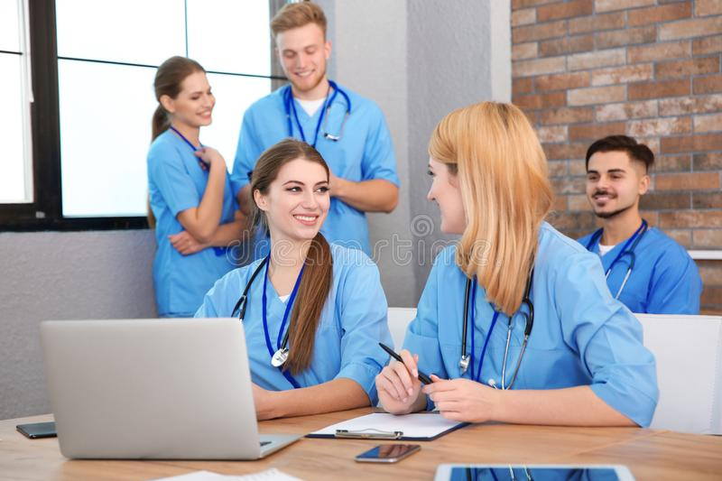Medical students in uniforms studying. At university royalty free stock photos
