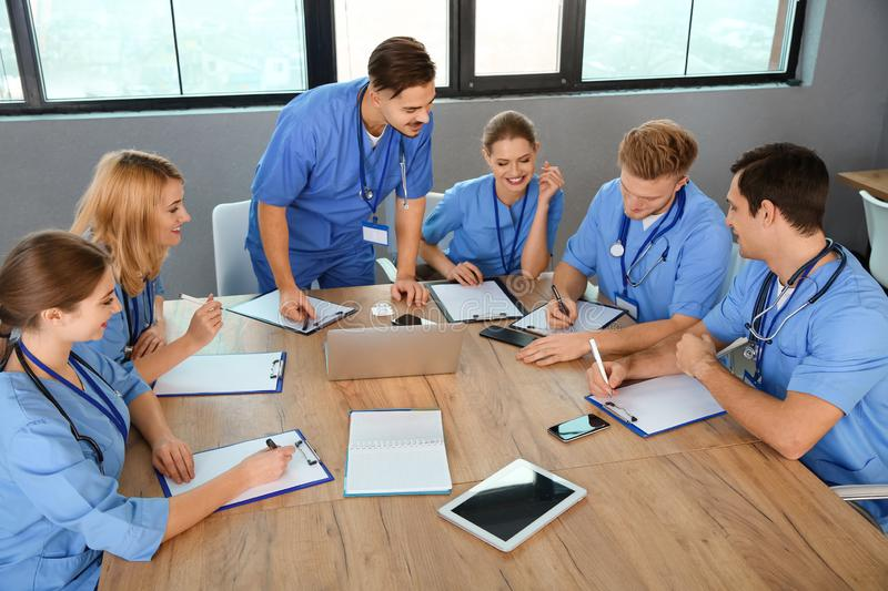 Medical students in uniforms studying. At university royalty free stock photography