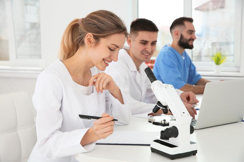 Medical students working in scientific laboratory. Medical students working in modern scientific laboratory stock image