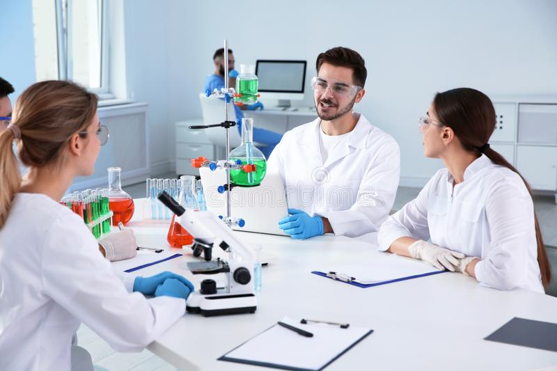 Medical students working in scientific laboratory. Medical students working in modern scientific laboratory stock photography