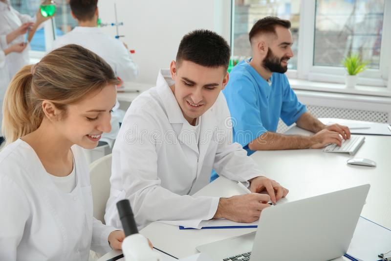 Medical students working in scientific laboratory. Medical students working in modern scientific laboratory royalty free stock photos