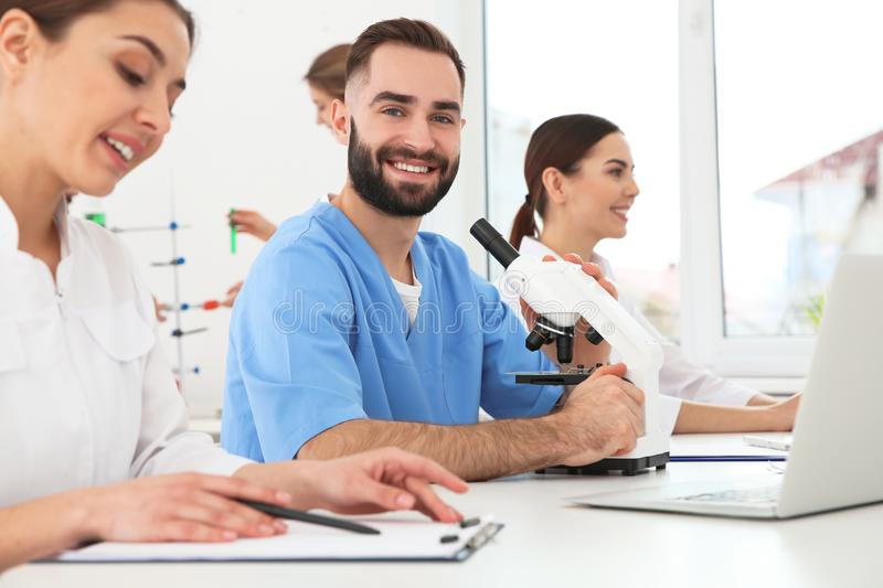 Medical students working in scientific laboratory. Medical students working in modern scientific laboratory stock photos