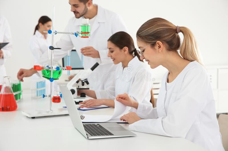 Medical students working in scientific laboratoy. Medical students working in modern scientific laboratory stock photos