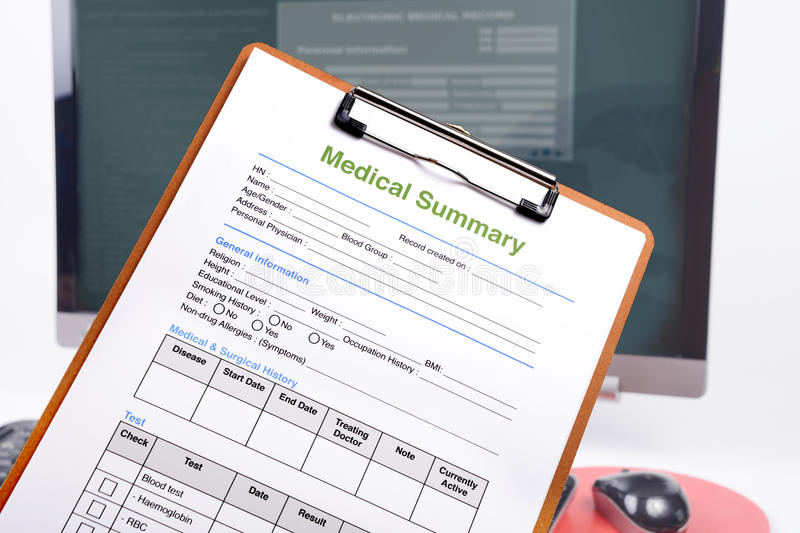 Medical summary on clipboard. Medical summary on clipboard in front of computer royalty free stock image