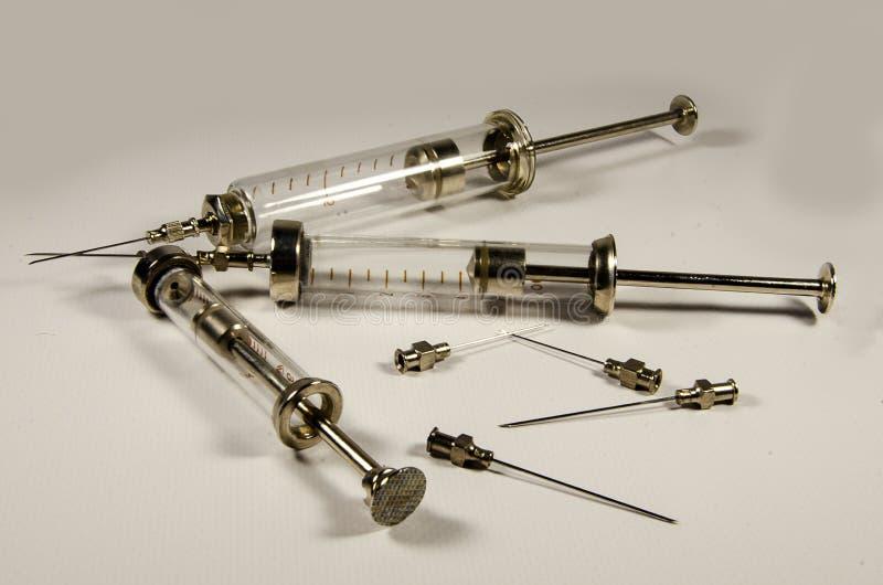Medical supplies. Retro syringe and needles stock photos