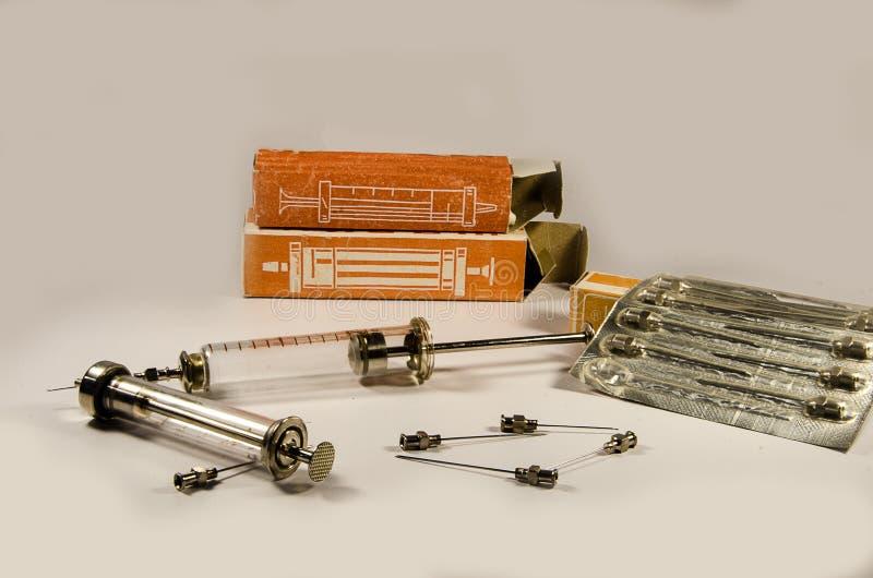 Medical supplies. Retro syringe and needles SSSR stock image