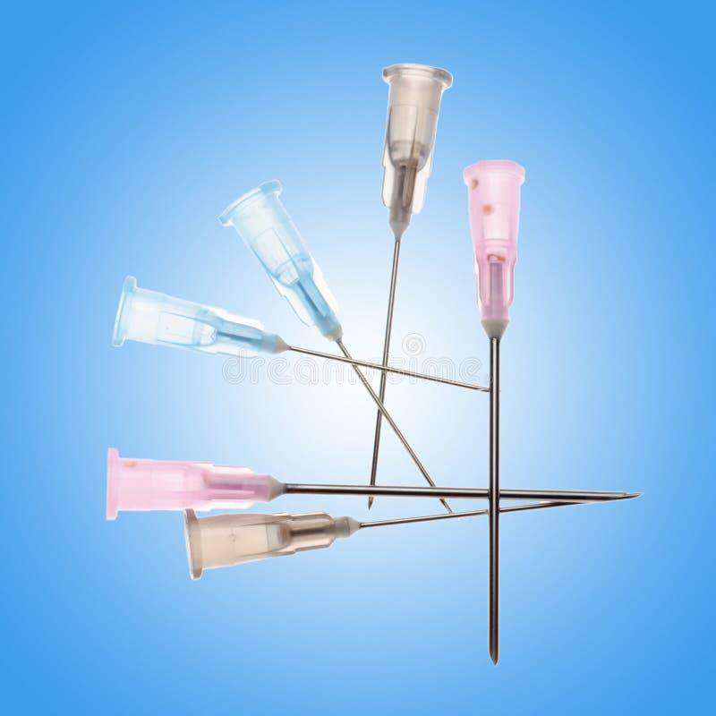 Medical syringe needle stock images