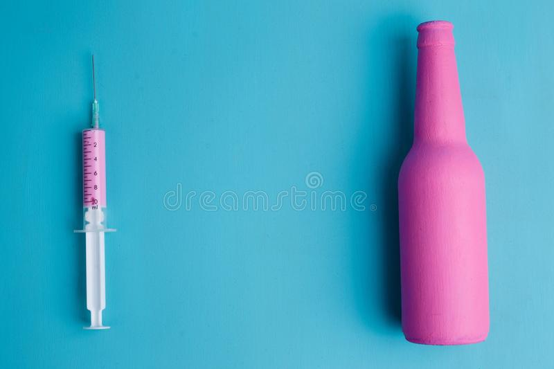 Medical Syringe With Pink Medicine And Pink Bottle Close Up