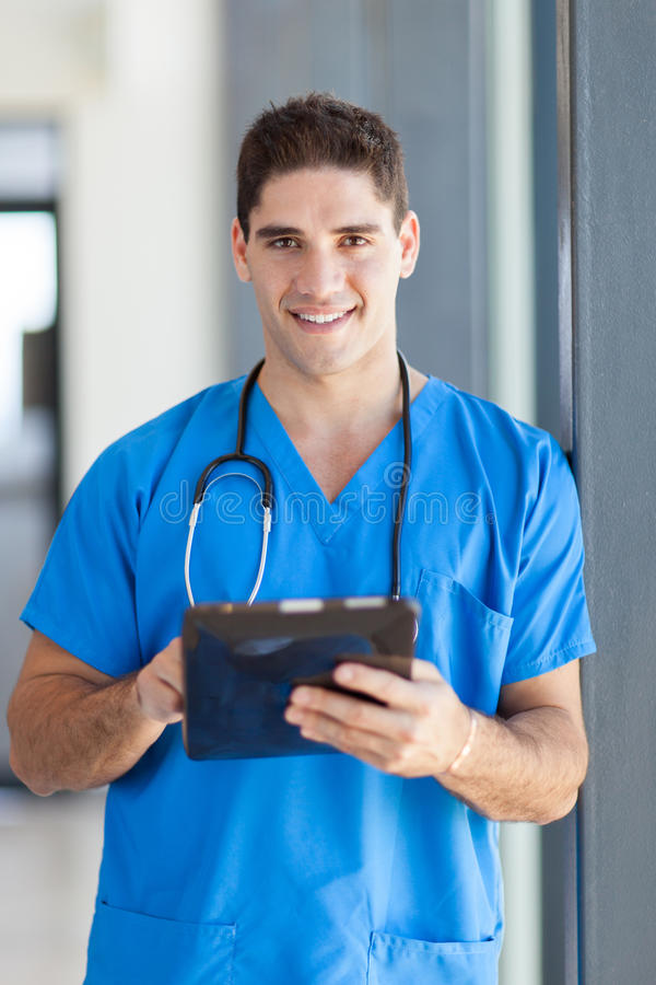 Medical tablet computer. Male medical doctor using tablet computer in hospital stock photography
