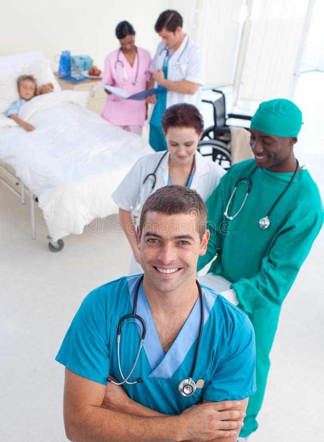 Download Medical Team Attending To A Child Stock Image - Image: 11270215