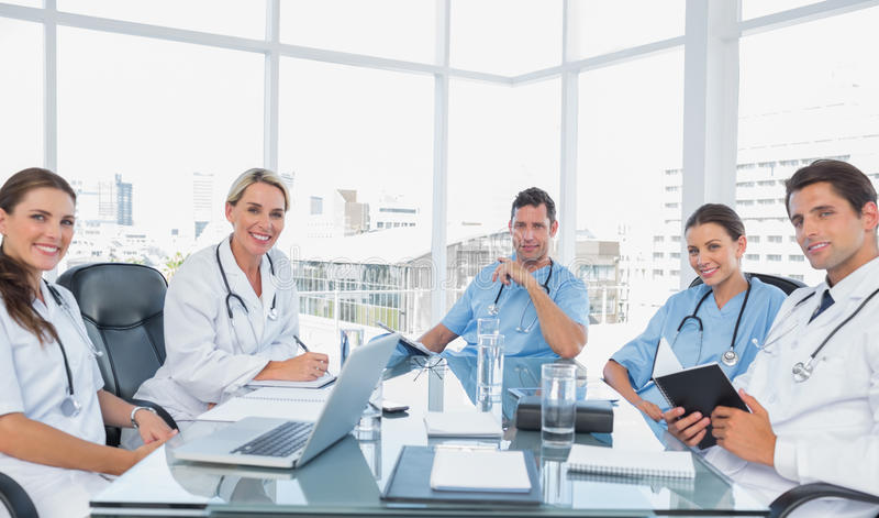 Medical team in a bright meeting room stock images