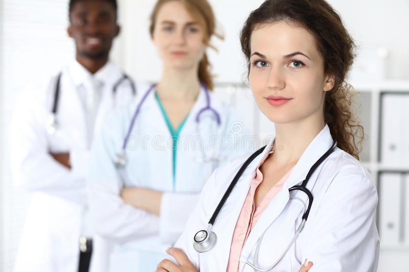Medical team of confident doctors ready to help. Medicine and health care, insurance concept royalty free stock photo