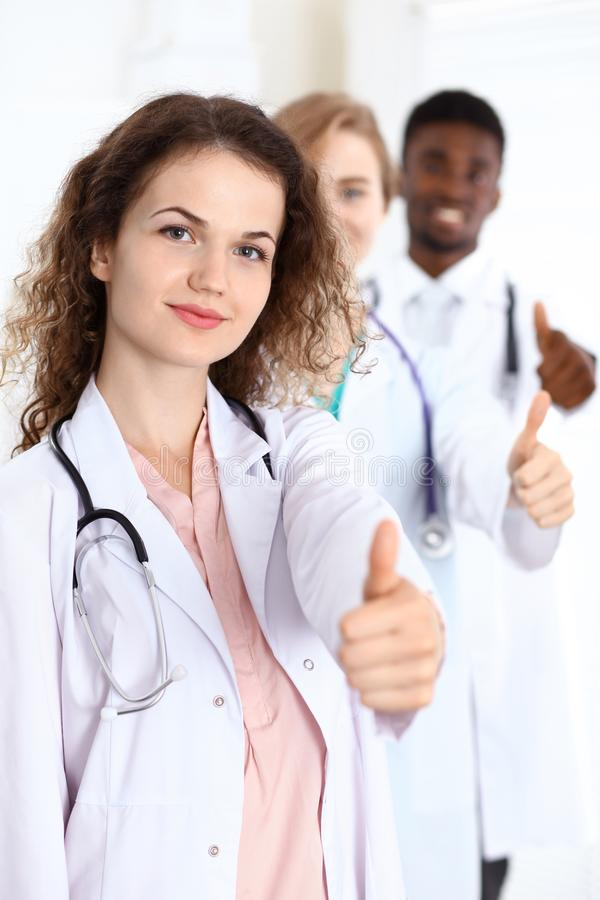 Medical team of confident doctors showing Ok sign with thumbs up. Medicine and health care, insurance concept stock photo