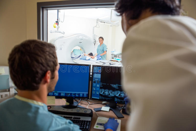 Medical Team In CT Scan Lab royalty free stock image