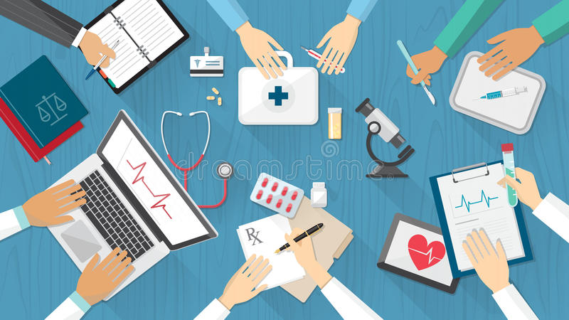 Medical team. Desktop with doctors and medical equipment