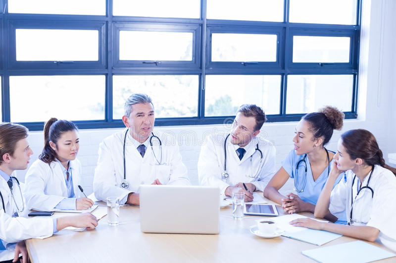 Medical team discussing in meeting. At a conference room royalty free stock image