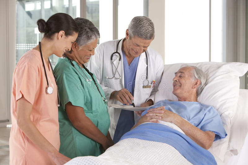 Medical team discussing results royalty free stock photos