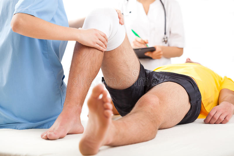 Medical team examining knee condition stock photos